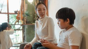 adult asian mother and children spending time at home